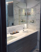 bathroom fit out dubai, remodelling business bay, executive tower, walk in shower, built in bathroom shelves, storage, marble, under counter basins, special lighting, interior design dubai, consultation, bagno bathrooms, mirror storage, light, storage above wc, laundry basket build in storage, before and after bathroom, bagno design, photoshoot