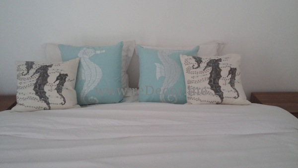 beach style guest bedroom interior white and aqua Rak dubai