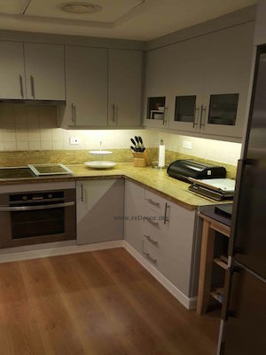 renovated kitchen in greens, dubai, design, colours, grey kitchen Dubai design, renovations