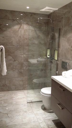 bathroom remodelling Dubai, before and after in the greens, walk in shower