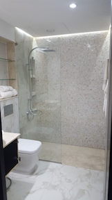 old greens bathroom renovation, remodelling, design, modern, marble, walk in shower, dubai, marble basin, built in shower shelves
