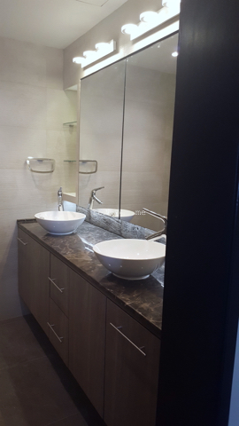 fit out bathrooms dubai, renovation, remodelling, design powder room motorcity, dubai, stone slabs like wood, 3D tiles, mirror light, recycle, master bathroom complete remodelling, big bathroom, walk in shower, 2 basins, mirror, brown marble counter