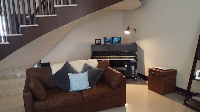 piano in the big house, under staircase area, beautiful big art, entrance console, villa decor consultation, organise villa, rental property, dubai designer consultation, marina furniture, trendy rugs, art, beautiful living, antique plates on wall, plants, big living area