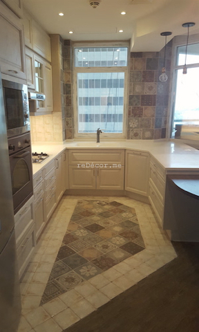 wall tiles, kitchen fitout dubai, dubai kitchen design, louvered cabinets, corian work top, consultation, dining kitchen, french decor tiles,dubai marina crown, top bar lighting, built in one piece basin, unusual floor space for kitchen